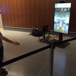 Smithsonian visitor trying Zugara Virtual Dressing Room technology